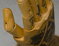 Wooden hand tattooed