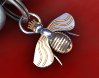 Textile design: gold and silver charms