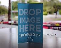 Brochure Mockup Standing on Top of a Restaurant Table