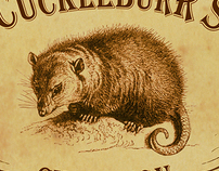 Uncle Cockleburr's Champion Possum Carvers logo