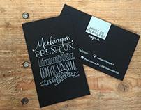 Lettering on business card for Margt og Merkilegt