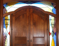 Black Walnut Entranceway With Stained Glass Surrounding