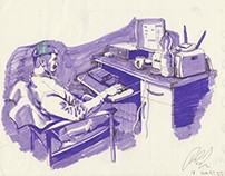 Figure seated in front of computer