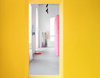 Pink furry walls and vibrant yellow surfaces.