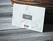 Free Texture Paper Business Card on Wooden Table Mockup