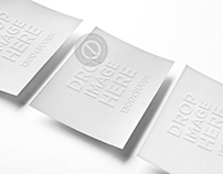 3 Business Cards Lying Over a Smooth Background