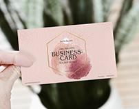 Free Girl Holding PSD Business Card Mockup Design
