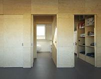 Zolder door garderobe opgedeeld in twee kamers