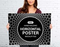 Free Hand Holding Horizontal Poster Mockup PSD