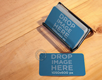 Business Cards Placed Over a Metal Business Cardholder