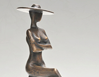 Bronze statue of sitting lady with hat -limited edition
