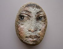 Face paintings on stones