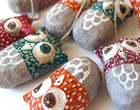 Colorful paper mache owls