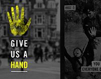 Give Us A Hand - Amnesty International