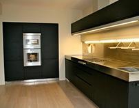Arclinea Convivium kitchen black oak with inox worktop