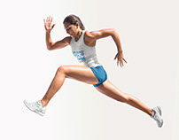 Track and Field Uniforms - Girl Jumping Against Solid