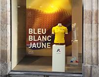 Escaparate Le Coq Sportif - Bleu, Blanc Jaune, en BCN