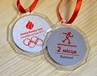 Acrylic medal with a metal plate