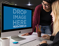 Pair of Women Using an iMac Template at the Office