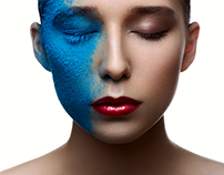 Fashion beauty Girl with blue Snow on Face