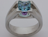 White gold ring with aquamarine and inverted amethyst