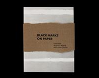 Black Marks on Paper