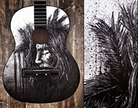 Black Feather on a guitar