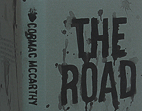 Book Cover - The Road by Cormac Mccarthy)
