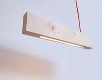 Défier la gravité lampe 2×4 par Alexandra Burr
