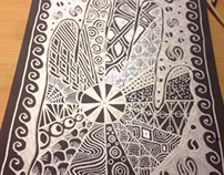 Black journal with silver pen