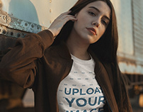 Mockup of a Girl Wearing a T shirt and a Vintage Bomber