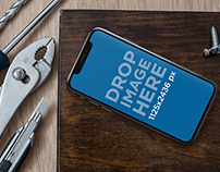 iPhone X Mockup on a Workshop Table