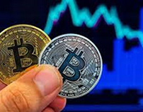 Holding Bitcoins | Image source: latimes.com