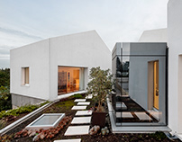 Rio House in Portugal by Paulo Merlini Architects