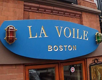 La Voile Newbury Street [lamp sign]