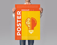 Man Holding Poster Mockup PSD