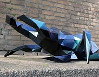 geometric kamelon-painted beetle sculpture