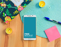 Free mockup: Galaxy Note With Two Yellow Candles