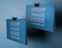 Mockup of 2 Brochures Being Held by Paper Clips