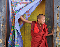 A young monk in Bhutan outside of the fire festival