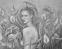 Girl in flowers drawing with pencil