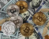 Bitcoins on top of dollar bills