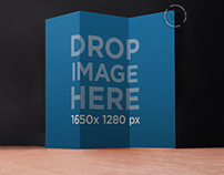 Brochure Mockup Standing Over a Wooden Surface