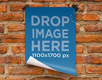 Poster Mockup Featuring a Poster Taped to a Brick Wall