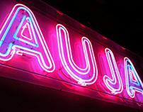 AUJA. A neon object.