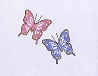 FLUTTERING COLORFUL BUTTERFLY EMBROIDERY DESIGN