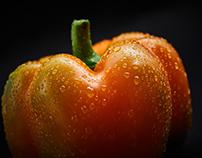 Fresh fruits & vegetables on dark background