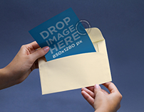 Envelope Mockup Featuring a Person Opening an Envelope