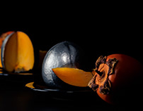 Silver persimmons in front of the mirror, reflections.