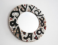 Mosaic letters and a mirror